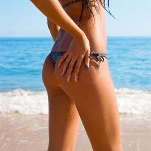 stock-photo-slim-tanned-figure-girl-against-the-sea-100203557